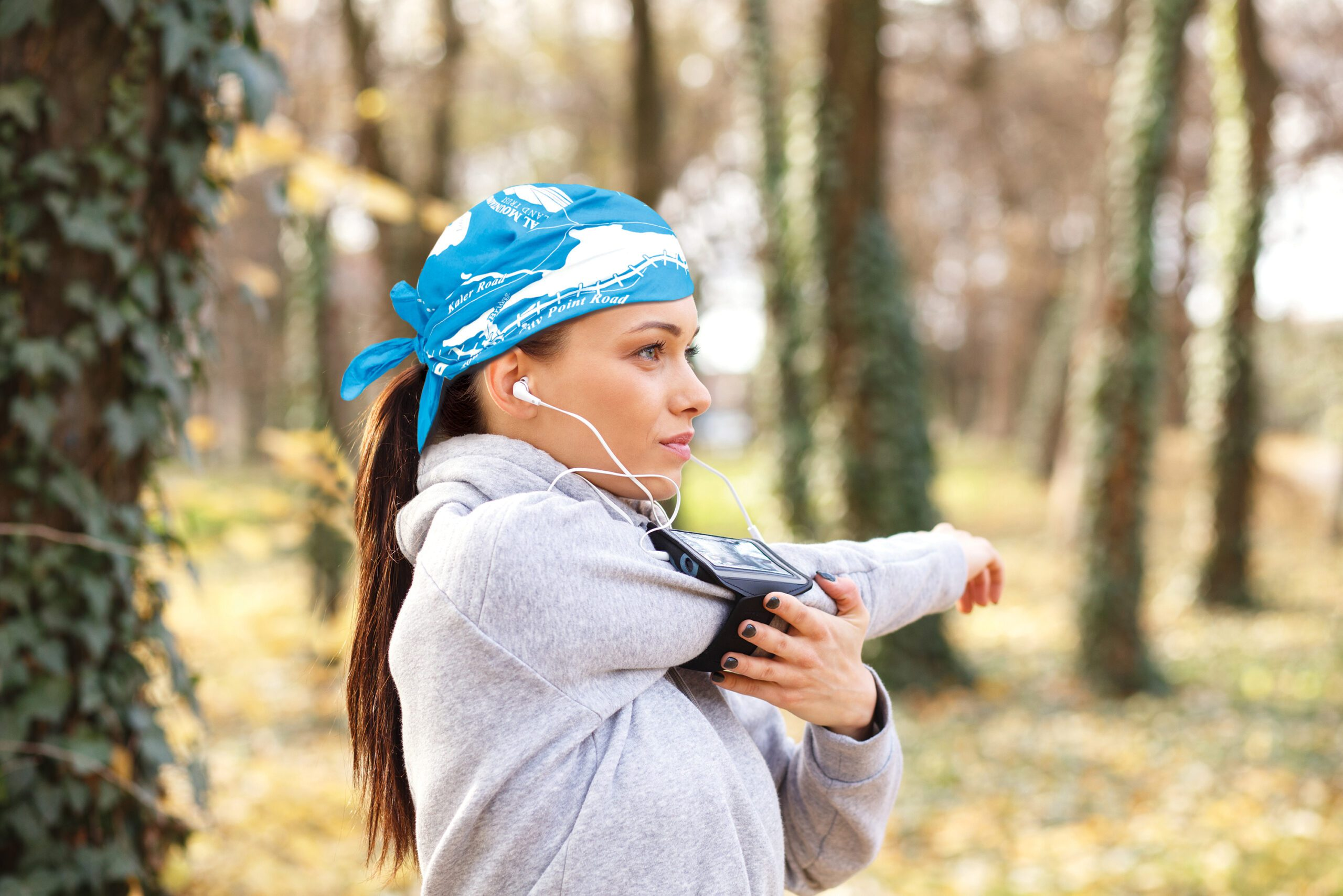 girl wearing bright blue bandanna getting ready for fitness run