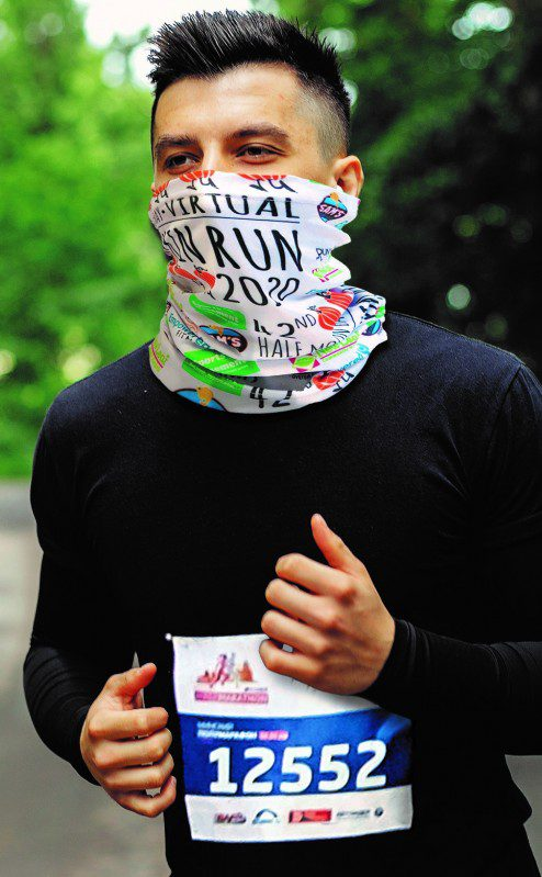 man running face covered by bandanna